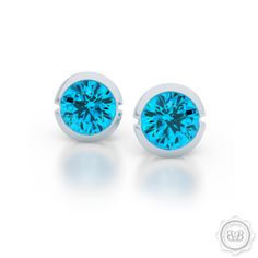 Free Shipping to USA. Little Luxuries. Little Darling Martini Stud Earrings. Genuine Blue Topaz set in Sterling Silver or  White Gold. Bashert Jewelry Custom Fine Jewelry Boca Raton Florida