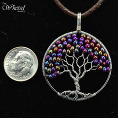 Wire Tree of Life Necklace Pendant Glass Beads - Sterling Silver Pendant - Wire Wrapped Jewelry by Tim Whetsel This wire tree of life necklace pendant was constructed with .925 sterling silver wire. The tree of life contains color shifting glass beads that give appearance of autumn foliage to the tree. The glass beads display colors or red, purple, yellow, and pink. To accentuate the wrapped wire, I applied an antique finish and then polished the high areas to a bright luster. #wirejewelry