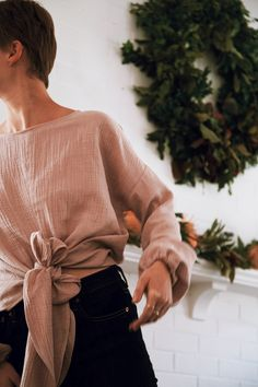 The Limited Edition Nancy Bow Top is a great alternative to a basic long sleeve top, and goes just as well with jeans or likely any other pair of pants you own. Order the top in our popular Dusty Rose color that is super soft and a great way to incorporate color to your outfit, or order the top in white for a crisp, elegant, winter look. #winterfashion #winterwhites #fashion #christmasdecor #modernhome #madeinusa