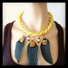 Collar Luvjan de seda con plumas, cerámica y cristal    www.facebook.com/bycosmicgirl