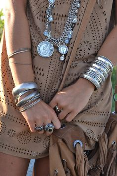 Bohemian style stacked bangles, silver bracelets, & cuffs, long gypsy coin layered necklaces, modern hippie cut out top.