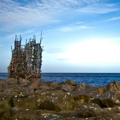Nimis, a labyrinthine public artwork made of 75 tons of driftwood, is the centerpiece of Ladonia, an unrecognized, artist-declared micronation in Sweden. One of its two national anthems is the sound of a stone thrown into the water. Via T+L (http://www.travelandleisure.com).