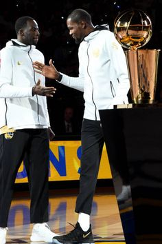 Kevin Durant and Draymond Green of the Golden State Warriors high five before they accept their 2017 NBA Championship rings on October 17 2017 at...