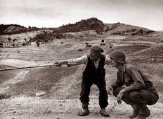US soldier with an Italian peasant, Troina, Sicily - 1943 (Photo by Robert Capa)