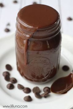 Irresistible Homemade Chocolate Fudge Sauce - the BEST recipe ever! Great on ice cream or funnel cakes! { lilluna.com } Just 4 ingredients - butter, chocolate chips, powdered sugar, and evaporated milk.