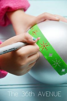 Decorate your old ornaments using Sharpies by the36thavenue.com