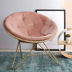 A beautifully luxurious round velvet chair for the cosiest of reading corners.Also available in emerald green - see product 'The Esmeralda Round Chair' for details.The Aurora round velvet chair is simplicity and chic rolled into one with the added bonus of comfort. Whatever your style, from vintage to rustic to minimalist, this chair fits the bill and we know this one is a winner. The curvaceous frame is wrapped in raffia with angular brass legs and a soft velvet buttoned cushion. DELIVERY…