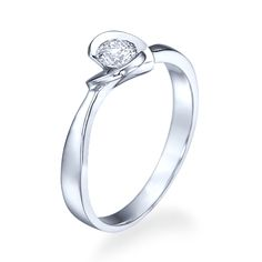 Gold ring romantic flower-shaped design and a diamond in it.