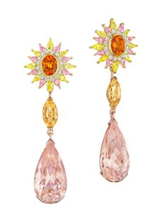MadStone one-of-a-kind Aphrodite earrings in a sunburst design made of mandarin garnet surrounded by white diamonds, yellow and pink sapphires. The drops are marquise-cut imperial topaz and pear-shaped morganite.