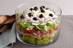 Bring this layered Greek salad to your next potluck. No matter their nationality, everyone will love our creamy, cheesy, spinachy, olive-studded Layered Greek Salad for a Crowd. You may even hear someone declare Kraft Recipes, Potluck Recipes, Salad Recipes, Cooking Recipes, Healthy Recipes, Crowd Recipes, Family Recipes, Seafood Recipes, Family Meals