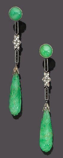 A pair of art deco jade, diamond and onyx pendent earrings, circa 1925 Each circular cabochon jade surmount suspending a pendant of calibré-cut onyx highlighted to the centre with single-cut diamonds, terminating with a carved jade drop with a rose-cut diamond set cap, length 6.5cm., cased by Spink & Son