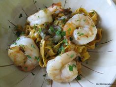 Red Pepper Linguini Pesto with Shrimp Posted by Anne ~ Uni Homemaker      This is the second time I have made pesto sauce from scratch.  It tastes so much different than the stuff you get at the store.  When you make it at home, there's that taste of freshness that you don't get with store bought pesto.  I highly recommend making it yourself if you have the time.  Ingredients:  12-14 large size raw shrimp, peeled and deveined 2 shallots, sliced olive oil for cooking 1/2 pound of fresh red…