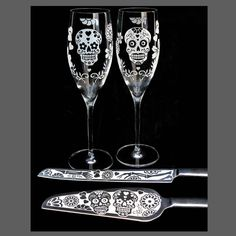 AHHH I TOTALLY WANT THESE!!!!  HOW COOL!!!! (got them at my bridal shower with our names and wedding date etched on the bottom, WOOHOOO!!!!)   Sugar Skull Champagne Flutes, Dia De Los Muertos Wedding Flutes