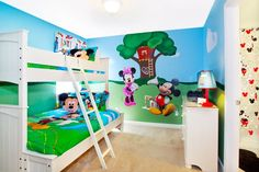 """In the vacation home 7754 Teascone Blvd, kids will enjoy spending time with Mickey, Minnie and their Disney friends in this """"Mickey Mouse Clubhouse""""-themed bunk bedroom."""