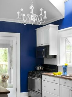 Cobalt blue walls in the kitchen. I think I might do this...I really like it!