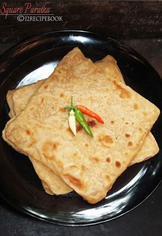 Naan is an indian flat bread that is usually made in tandoor or oven square paratha recipe book forumfinder Images