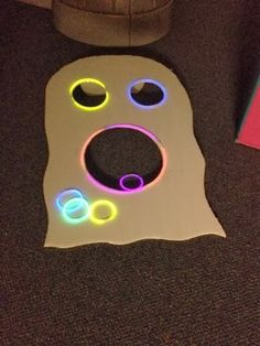 Glow in the dark ghost ring toss. Gross motor - Adventures in Preschool