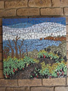 Wall panel mosaic, Aireys Inlet, Victoria, Australia, made of ceramic tiles, china, pebbles and glass.