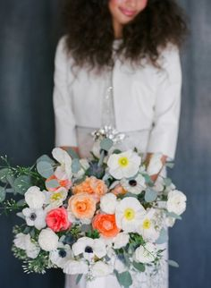 White and green bouquet with pops of peach and orange by Bare Root Flora