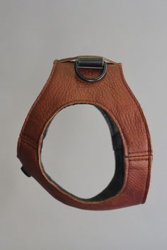 Developed for the urban dog, the Doggy Vest is a great product that looks stylish and provides a comfortable restraint. The innovative design conforms to the shape of the dog, enhancing it's natural beauty. Features include: -Soft imported South American leather -High strength, scratch resistant powder-coated hardware