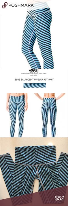 Teeki Blue Balanced Traveler Hot Pant Before your adventure slip on Teeki's Balance Traveler Hot Pant staying in flow with the planet.With four way stretch to expand your muscles in all movement, elastic free, breathable to reach the highest peaks, chafe resistant and antibacterial.   Material: 79% recycled plastic 21% spandex Made with love in the USA teeki Pants Leggings