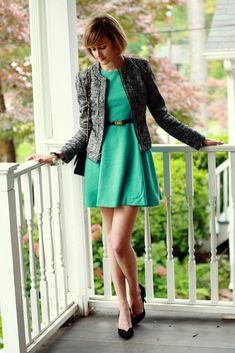 A dress in a very pretty shade of green. I also love the structured jacket.