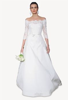 Carolina Herrera's Carmen bridal gown is gorgeous epitomised, from the off-the-shoulder neckline to the delicate A-line skirt.