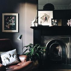 Farrow and Ball walls in London Clay, mid century Danish leather chair, Victorian fireplace.