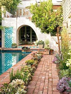 Break up a stretch of patio with beds of plantings.