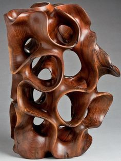 Standing vertically, Harry Pollitt's wood sculpture in Windshake Walnut