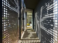 one workplace headquarters by design blitz Perforated panel metal facade different sized openings shadow in hall by frankie