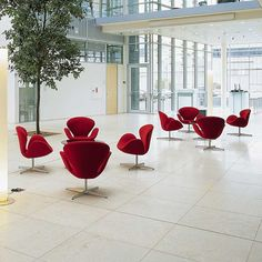 MLF® Arne Jacobsen Swan Chair in Red. Only $479 - Premium Cashmere & Hand-Sewn. 360° Swivel, Polished 4-Star Aluminum Base with Plastic Pads. Single Reinforced Fiberglass Shell, Elegant Swan Shape & Multi-Density Foam Facilitates Relaxed Sitting Posture. Shop at Amazon.com!