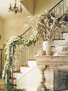 Christmas Staircase Decorations | White dendrobium orchids and silver fir cascade down the stair rail ...