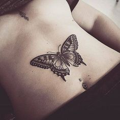 Butterfly tattoo on the stomach. Más