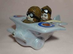 Pilot in WWI airplane condiment set salt and pepper shakers Condiment Sets, Pickle Jars, Salt And Pepper Set, Salt Pepper Shakers, Cookie Jars, Wwi, Airplane, Pilot, Gadgets