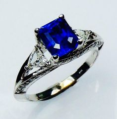 GIA Certified 14kt White Gold 1.93 tcw Blue Emerald Cut Natural Ceylon Sapphire & Diamond Ring - GIA G. G Appraisal Value $9,498.44 for sale wholesale $3995.00 at Sapphire Ring Co 727 797 0007.