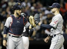 Cleveland Indians starting pitcher Corey Kluber celebrates with catcher Yan Gomes as they walk to the dugout after the sixth inning against the Chicago White Sox, Thursday, Sept. 7, 2017, in Chicago. (AP Photo/Nam Y. Huh). Indians won 11-2