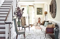 Entry with layers of art and accessories.