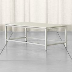 Shop Era Limestone Rectangular Coffee Table.   Stretchers at the base add both support to the frame and graphic interest to the design.  The Era Limestone Rectangular Coffee Table is a Crate and Barrel exclusive.