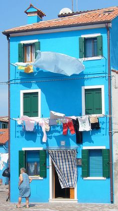 """""""Burano, Italy Laundry lady & her fabulous blue house * By ZedBee Zoë Power"""" Himmelblau, Windows And Doors, Architecture, House Colors, Hanging Out, Venice, Beautiful Places, Beautiful Boys, Around The Worlds"""