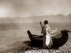 Here for your enjoyment is an exciting photograph of a Kutenai Woman. It was made in 1910 by Edward S. Curtis.    The photo illustrates Woman holding paddle, standing by canoe at edge of lake, probably in Idaho or Montana.    We have compiled this collection of photos mainly to serve as a vital educational resource. Contact curator@old-picture.com.