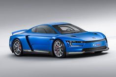 The Volkswagen XL Sport, shown at the Paris Motor Show, houses the V-Twin adapted from the new Ducati 1199 Superleggera, the world's most powerful two-cylinder motorcycle. Volkswagen, Supercars, Convertible, Automobile, Motorcycle Engine, Motorcycle News, Futuristic Cars, Sports Pictures, Funny Pictures