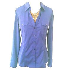 Fitted Shirt Great For Work Beautiful top to wear with a skirt or pants buttons on the sleeves to roll up and button. The buttons in the front are for show only there is a side zipper to access the shirt. Express Tops Button Down Shirts