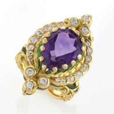 An American Art Nouveau 18 karat gold ring with amethyst and diamonds by Marcus & Co.. The ring has a pear shape amethyst with an approximate total weight of 5,20 carats, and 23 Old European-Cut diamonds with an approximate total weight of .70 carats. The Art Nouveau ring is further enhanced with green enamel. c 1900