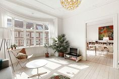 Bright house interior design with a wooden floor