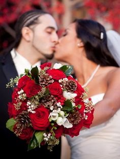 Red roses winter wedding bouquet