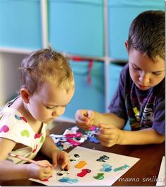 Sticker play is a fun, low-mess activity that helps toddlers develop fine motor skills and storytelling.** Also great to incorporate older siblings!