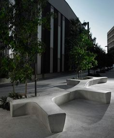 Twig concrete seating : Suited for a very modern area, the Twig concrete seating offers resting space for the urban traveler. The design resembles the form of a twig but the concrete masks any idea of eco-friendly  intention. Twig is the perfect touch in a modern urban area. This system of benches invite to rest and enchant with  its round edges and modular design.