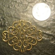 Ovalish bronze tone embellishment $.10