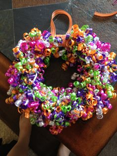 Birthday Wreath...use up gift ribbon and bows and add a pic frame yo put up the week of kids bday